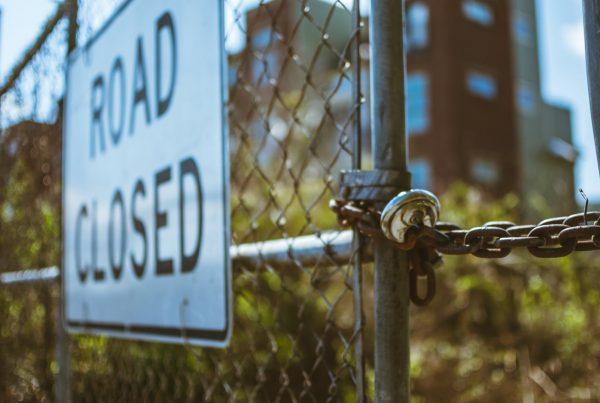 roadblocks-sign-fence
